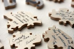 guest book puzzle..have an engagement pic made into a puzzle and have guests each sign a back peice..