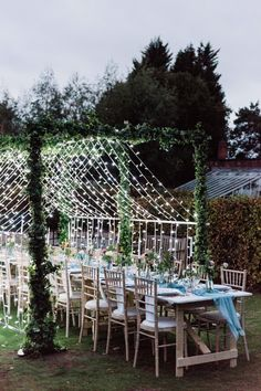 Fairy lit canopy over wedding table, set up in garden with blue silk runner. Top Table Ideas, Unique Wedding Stationery, Wedding Details, Wedding Ideas, Copper Lantern, Ribbon Bouquet, Walled Garden, Canopy Lights, White Candles