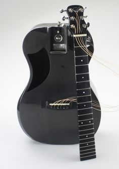 Not pretty but TSA-proof -- Carbon Fiber Travel Guitar - The Overhead | Journey Instruments
