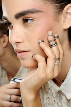 eyebrows + ring stacks for days at chanel couture fall 2013 show