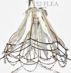 Shabby chic bedroomlove the vintage wire lamp shades for the 52 flea the gypsy paintbrush at bouckville 2013 can i reuse a cagepanniers with fabric or ribbons as a chandelier lampshade frame greentooth Gallery