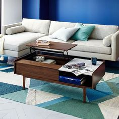 """$599  Dimensions: 48""""w x 24""""d x 17.4""""h. Mid-Century Pop-Up Storage Coffee Table"""