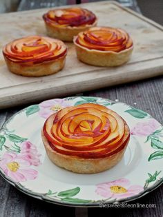 Individual tarts with cream cheese filling and topped with a fresh summer peach