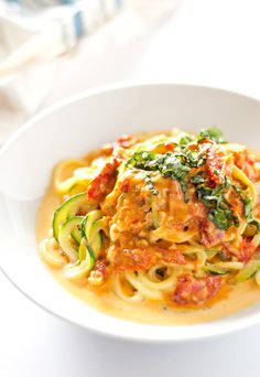These zucchini noodles with sun dried tomato cream sauce cook up in under 60 minutes, with the perfect combo of cream, Parmesan cheese & sun dried tomatoes!