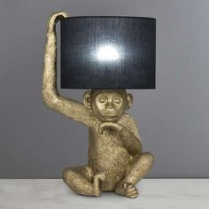 This monkey table lamp would be sure to add some character and charm to any room. It features a resin monkey figurine, finished in a brushed gold colourway with. Table Lamp Shades, Bedside Table Lamps, Touch Lamps Bedside, Rustic Hallway Table, Monkey Decorations, Animal Lamp, Elephant Home Decor, Deco Originale, Gold Table
