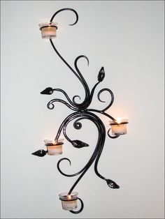 Hand Forged Iron Vine Scrollwork Sconce by VinTin. via Etsy.