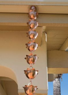 I love the look of this copper lotus rain chain! Living in Japan for quite some time, I have grown to love these things because they are super effective and are used quite frequently there. Not only would this enhance the look of your home, but it would definitely be functional in allowing the rain a nice path back to the ground from your roof gutter. Thanks for posting!
