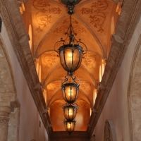 Soft warm lighting to highlight the ceiling detail and create ambiance