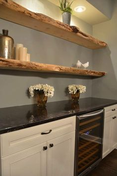 shallow counter with mini fridge would be great for basement kitchenette. love the idea of floating shelves downstairs too