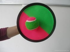 Those throw the ball and it sticks to the velcro thing toys.