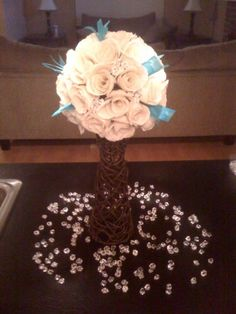 if whatever is sprinkled around the flowers was scrabble pieces it would make a fun activity for guests!!!:)