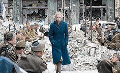 German rape victim walks past Soviet soldiers Film Woman in Berlin