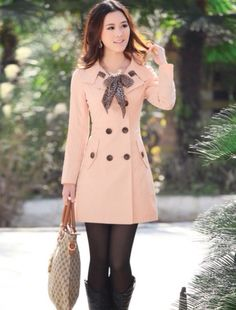 Gorgeous button coat with tights and long boots