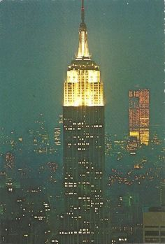 The Empire State Building (Shreve, Lamb & Harmon, 1931), on foreground and the Twin Towers of the World Trade Center (Minoru Yamasaki-Emery Roth & Sons, 1973. Destroyed in 2001) under construction on background, at right in this night view looking south from the R.C.A. Building in Early 1972.