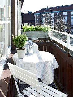 The Great Outdoors, Small Space Style: 10 Beautiful, Tiny Balconies.  From Stadshem, via Delikatissen, proof that even a very narrow balcony can be a lovely spot to hang out. The hanging planter box definitely comes in handy here.