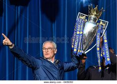 Claudio Ranieri holds the Premier League trophy won by Leicester City FC. (Stock Photo) Contributor: WENN Ltd / Alamy www.alamy.com http://www.alamy.com/stock-photo-leicester-city-fc-trophy-parade-and-party-in-victoria-park-featuring-115193430.html