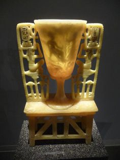 Magic Chalice of King Tut 18th Dynasty Carved alabaster (calcite) The hidden scene becomes visible when lit. This side shows Ankhesenamum, Tut's wife, presenting him with two long palm branches symbolizing millions of years