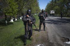 Ukrainian government troops patrol on a country road outside the town of Svyitohirsk near to Slovyansk, eastern Ukraine, Saturday, April 26, 2014. Ukrainian authorities are undertaking a security operation to liberate the nearby city of Slovyansk, which is currently controlled by an armed pro-Russian insurgency.