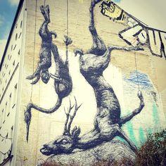 Hanging Dead Animals by ROA - Street Art in Berlin, Germany, Europe