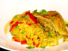 arroz con pollo    yea we eat alot of chicken w/ rice @ home. and by alot i mean too much