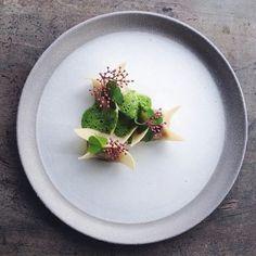 Scandinavian dumplings of apple and fennel foamed wood sorrel and black lace elderflower. Dish by @adelasterfoodtextures by tastefullyartistic