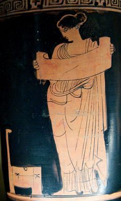 Musa reading a volumen (scroll), at the left an open chest. Attic red-figure lekythos, ca. 435-425 BC. From Boeotia.  Louvre Museum, Paris.