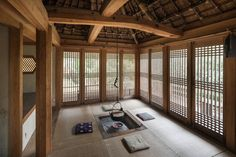 The interior of the garden house, with an irori firepit, sliding wooden screens, tatami mats and underfloor heating.