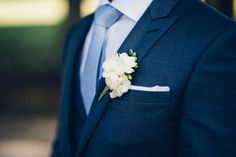 Groom in blue suit, light blue tie and white boutonniere for a spring wedding {Bryan Sargent Photography}