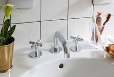 """Love the classic x-base handles on this modern-meets-retro chrome sink! Get inspired to make your own bathroom makeover happen with the tips and ideas from """"A Contractor-Free Bathroom Renovation You Wont Believe!"""" on the One Kings Lane Style Guide! Small Bathroom Tiles, Yellow Bathrooms, Diy Bathroom Decor, Bathroom Renos, Bathroom Colors, Bathroom Flooring, Bathroom Interior Design, Bathroom Renovations, Floor Grout"""