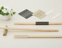 Cohana Origami Hashi Chopstick Decoration Set - The Cohana Origami Hashi Chopstick Decoration Set is a collection of paper crafts for adding an extra touch to your household cutlery. The set has decorative paper for special occasion chopsticks (called rikyu-bashi) in three colors (white, black, gold), each in classic motifs and origami folded sty ...