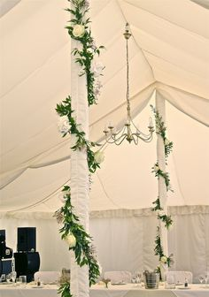 Reference for ivy twisting round poles, or across marquee to form canopy amongst fairy lights