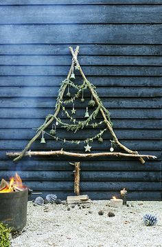 Christmas in the garden... I think I would like to do this with little ornaments made from suet and birdseed . . .