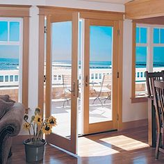 French doors would look so beautiful going out to a back patio and as an entrance to the dining room.
