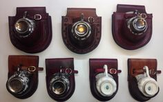 Hand made leather teacup holsters I did for steampunk tea duels Top row retails $150 Bottom $100 Cups and saucers not included