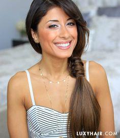 Mimi wearing a loop side ponytail