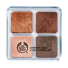 The body shop.com shmmer cubes palette 06  brush taupe eyeshade on lids, gold at creases, and bronze along lower lashlines. then apply black eye liner and mascara. finish with a creamy coral lush and pink liquid lipstick