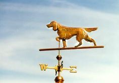 Irish Setter Dog Weathervane on Point by West Coast Weather Vanes. This copper Irish Setter Dog weathervane features glass eyes, gold leafed patterns and distinctive tooling which gives the fur a realistic texture on the body.  Personalized dog weathervanes can feature gold-leafing to bring out your pet's distinctive markings, as well as dog collars bearing your dog's name.
