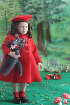 The first in my design series of Little Red Riding Hood, inspired by Missy (boopsie.daisy), is being modeled by Robert Tonner's Lucy Pevensie. The coat and hat are made of a fine red wool lined in silk. The hat, coat, shoes, socks, dress apron and wo