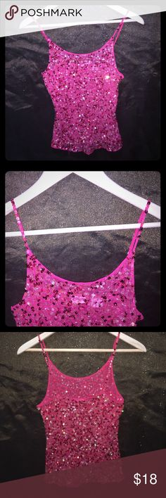 """TOGETHER Spaghetti Strap Sheer Sequin Tank Top SZM This is a used item for sale in very good condition. NO TEARS HOLES STAINS OR RIPS! As shown in picture there are 3/4 sequins missing from left strap. Everything else (sequins) are in tacked! TOGETHER Hot pink sheer mesh w/ pink & clear sequins tank top SZ M. Measurements are: length 22"""" Armpit to Armpit 14.5"""" Spaghetti Straps are not adjustable. Thank you 4 looking & don't 4 get 2 bundle. TOGETHER Tops Tank Tops"""