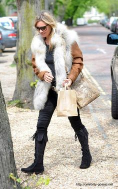 KATE MOSS IN THE FRONT LACE KNEE HI BOOT Kate steps out in her favorite Minnetonka style in London.  There are three colors to pick from- we have your size! Review off of: http://www.indianvillagemall.com/mocs/ladykneehiboot.html