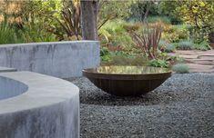 Bernard Trainor Associates, Garden Water Feature Roundup | Gardenista: Water flows over the edges of a bowl in a Los Altos Hills, Calfornia garden.