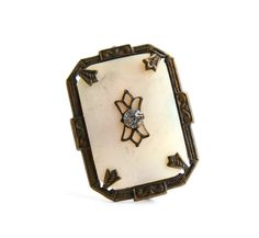 Hey, I found this really awesome Etsy listing at http://www.etsy.com/listing/152459175/antique-art-deco-brooch-vintage-mother