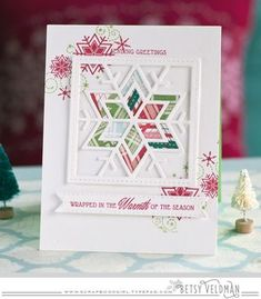 handmade quilt card ... Christmas colors ... plaid papers ... luv that the snowflake die cut quilt block is open in som areas to show background ...