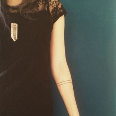Thin parallel lines - arm bands tattoo
