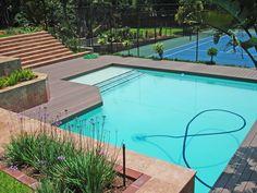 Garden #decking near pool and tennis court.