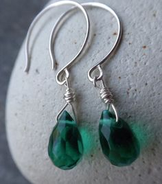 Was US$16.00 Sale US$10.00  Emerald Green- Simple little drop earrings in faceted glass and Sterling Silver. Candy for your Ears. Last picture shows a sample size. You will receive the color in the listing.    Not the color your looking for? I have 10 others, please visit my shop section colorful drop earrings.