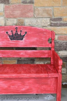This headboard bench was painted with Plaster Paint, given a crown, and then distressed.  It's a rustic beauty now!  girlinthegarage.net