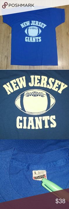 """Vintage 80s New Jersey Giants Football T-Shirt Med Great pre-owned condition  Tag Size:  L (but fits like a MEDIUM,  see measurements)  Measurements:       Chest (underarm seam to underarm seam):  19.5""""       Length (neck of neck seam to hem):  26.5""""   Color:  royal blue Fabric:  50% cotton, 50% polyester Brand:  Screen Stars Made in USA    Athletic,  fan gear,  sports Screen Stars Shirts Tees - Short Sleeve"""