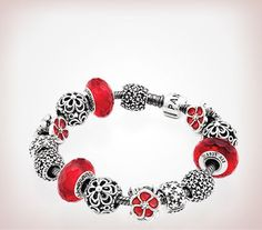 """""""Pandora. I like the delicate textures of the charms, set off by the red - Pandora Superfan"""" We love the color in this, we suggest multiple bracelets for different memories and styles with every outfit!:"""