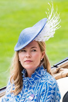 Autumn Phillips (granddaughter of Queen Elizabeth II) arrived to the events in a baby blue and white feather cap.